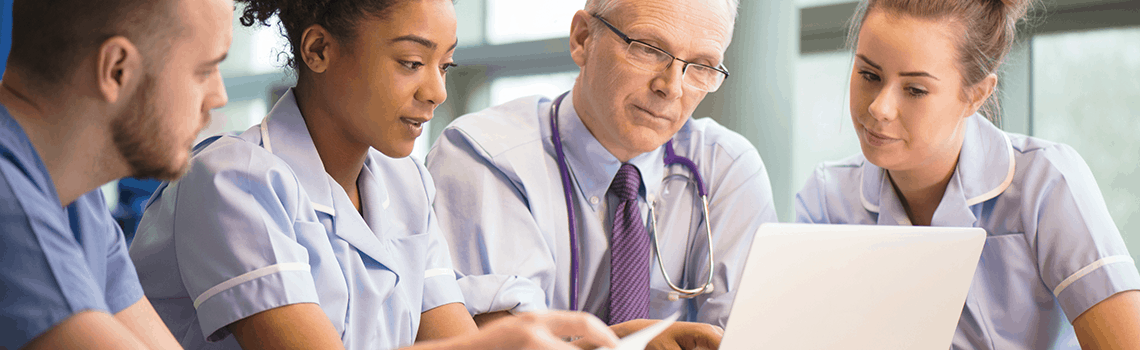 Healthcare staff reviewing OAS CAHPS results