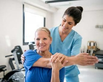 Rehabilitation with Patient and therapist